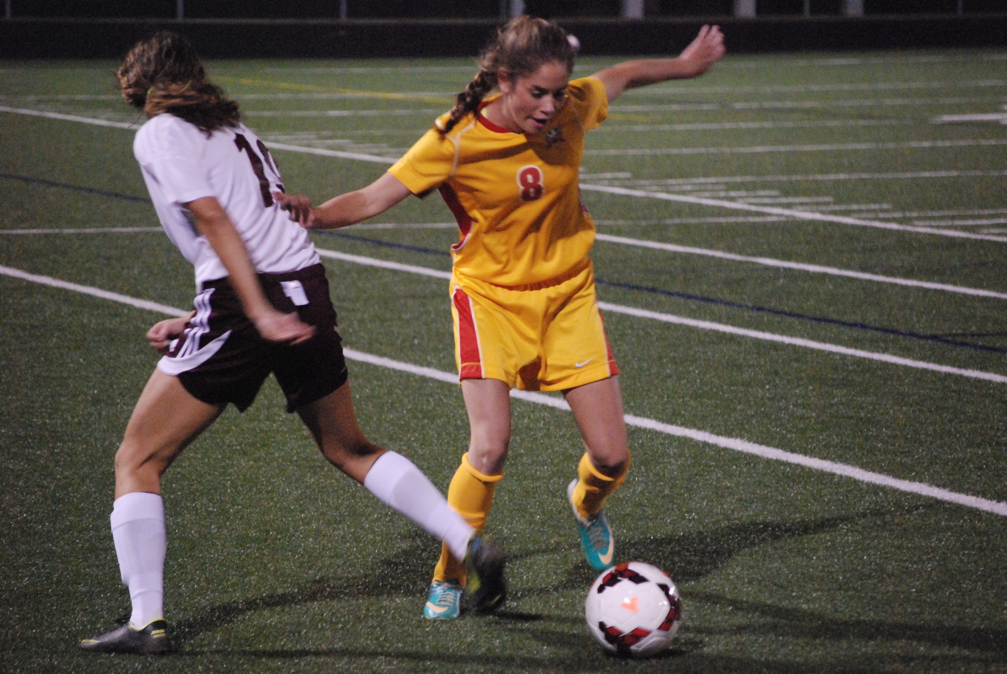 Fenwick sophomore Taylor Engle wins a ball against Columbus Academy sophomore Lily Rizk during first-half action the Division III regional semifinal match Tuesday night at Hilliard Bradley High School. Fenwick won the game 2-0 to advance to Saturday's regional final.